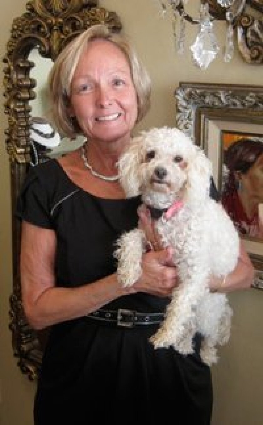 """Rancho Santa Fe Estate and Fine Jewelry owner Coleen Freeman with """"Sophie."""""""