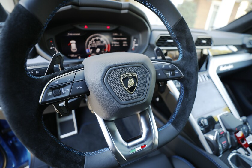 The Lamborghini Urus has a flat-bottomed suede and leather steering wheel.