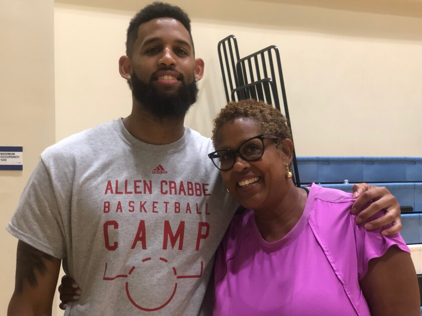 Allen Crabbe of the Atlanta Hawks with his mother, Cheryl, while running a camp at his alma mater, Los Angeles Price.