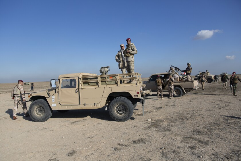 Iraqi army units provide security Sunday at an Anbar air base that hosts U.S. forces after a series of attacks on U.S.-led coalition forces.