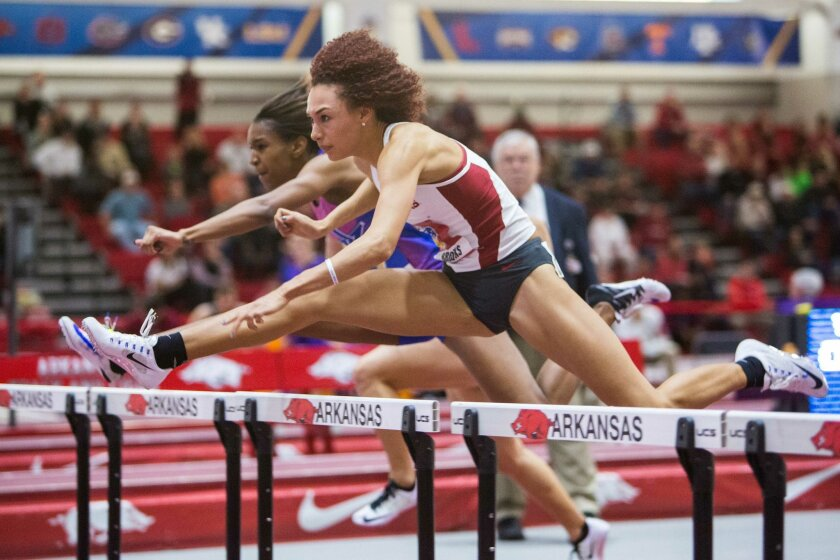 Arkansas' Taliyah Brooks leaps over a hurdle in the 60-meter hurdles event at the Southeastern Conference indoor track and field championships Friday, Feb. 26, 2016, in Fayetteville, Ark. (AP Photo/Gunnar Rathbun)