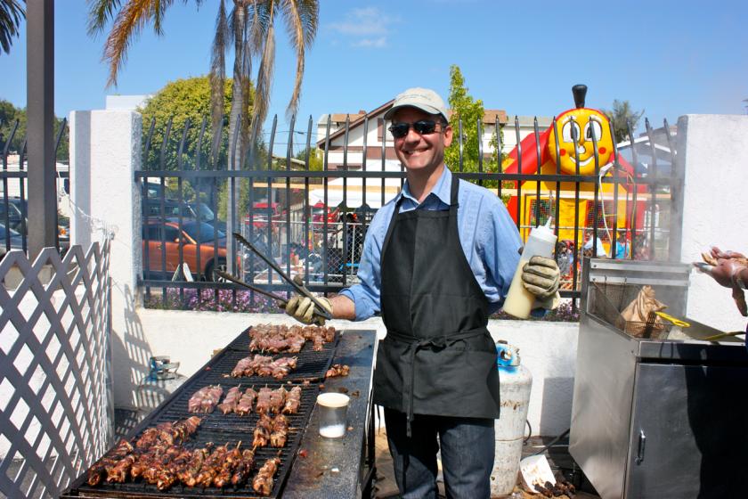 A volunteer grills souvlaki at a previous San Diego Greek Festival.