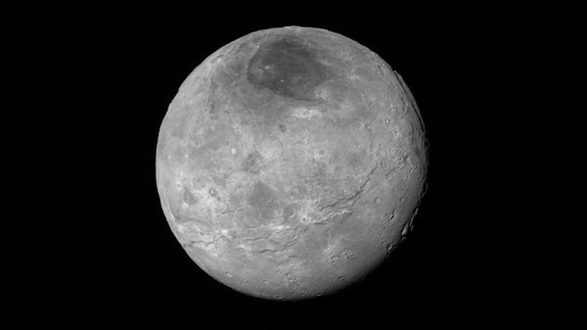 This image ofCharon showsrelatively smooth, fractured plains in the lower right; several enigmatic mountains surrounded by sunken terrain features on the right side; and heavily cratered regions in the center and upper left portion of the disk.