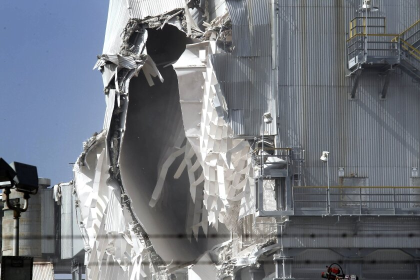 Damage caused by an explosion at the ExxonMobil refinery in Torrance, Calif. is visible on Wednesday, Feb.18, 2015, after an explosion in a gasoline processing unit. Two workers suffered minor injuries and a small fire at the unit was quickly put out. The incident triggered a safety flare to burn o