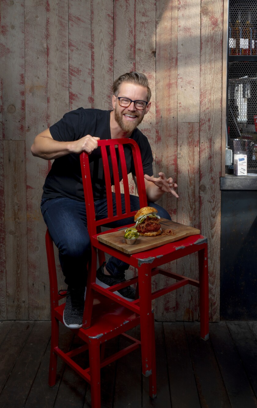 Chef Richard Blais of Crack Shack and his Firebird chicken sandwich.