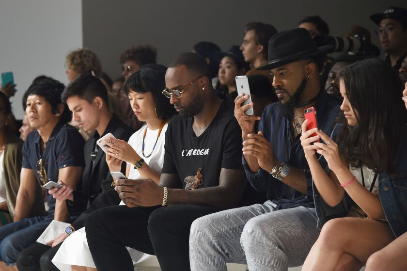 iPhones are a staple of the front row at General Idea's fashion show.