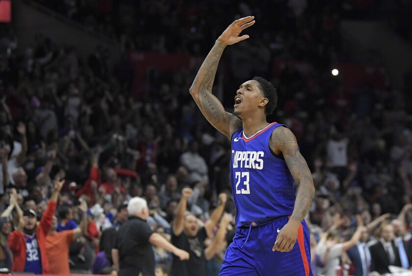 Clippers guard Lou Williams celebrates after scoring late in a game against the Wizards.