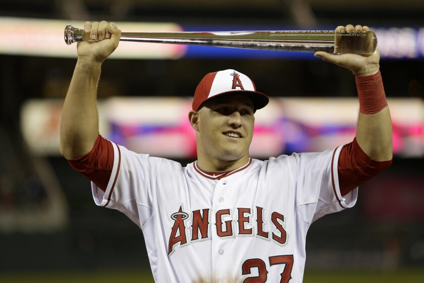 American League outfielder Mike Trout, of the Los Angeles Angels, holds the MVP trophy after his team's 5-3 victory over the National League in the MLB All-Star baseball game, Tuesday, July 15, 2014, in Minneapolis. (AP Photo/Jeff Roberson)