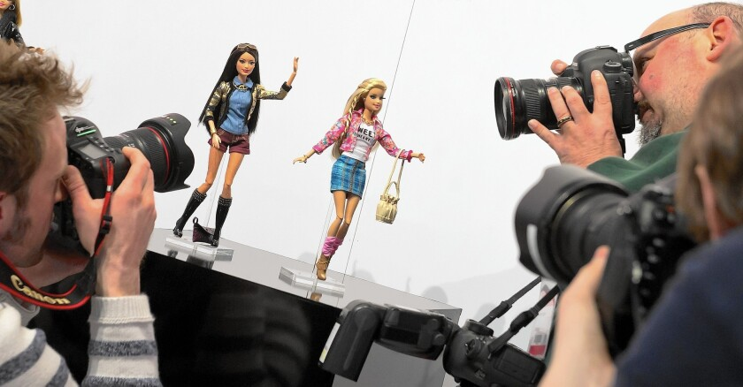 For the quarter that ended Sept. 30, Mattel reported that Barbie sales plunged 21%. Above, the Barbie Collection 2014 is presented at the Nuremberg International Toy Fair in Germany in January.