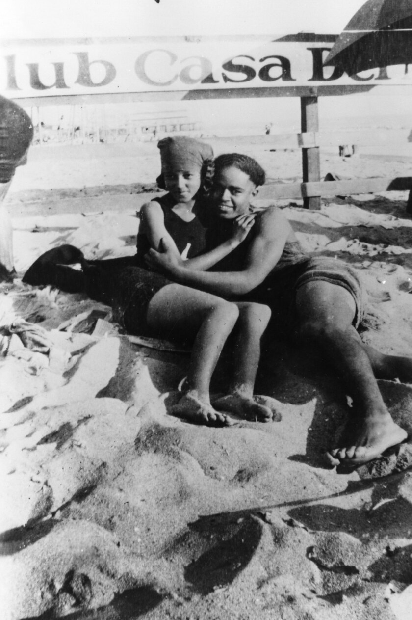 "A photograph featured in Carolyn Kozo Cole's project ""Shades of L.A"" of Verna Deckard and Arthur Lewis at Santa Monica Beach in the segregated section, Aug 2, 1924. They married later that month."