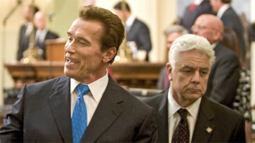 """The economics of this makes sense,"" Gov. Schwarzenegger said, left, asserting that the new costs would be $10 a year for the average California homeowner. ""Consumers and the state will end up saving money."""