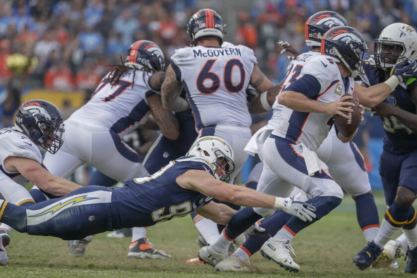 Chargers defensive lineman Joey Bosa dives at the feet of Denver Broncos quarterback Case Keenum during third quarter action at Stubhub Center on Sunday.
