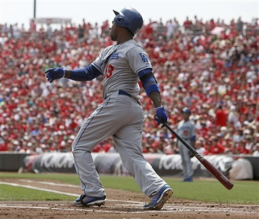 Los Angeles Dodgers Hanley Ramirez hits an RBI single off Cincinnati Reds starting pitcher Mat Latos in the first inning during a baseball game, Saturday, Sept. 7, 2013, in Cincinnati. (AP Photo/David Kohl)