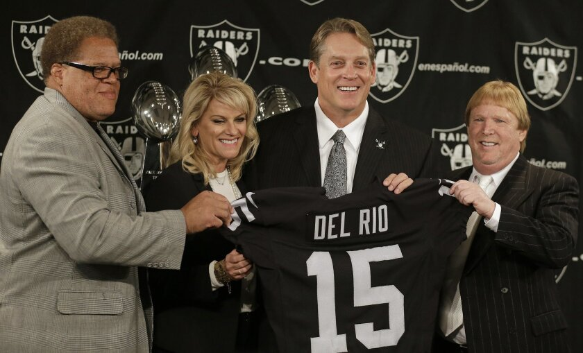 From right to left, Oakland Raiders owner Mark Davis, new coach Jack Del Rio, Jack's wife Linda Del Rio and general manager Reggie McKenzie pose after a news conference Friday, Jan. 16, 2015, in Alameda, Calif. (AP Photo/Ben Margot)
