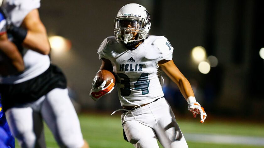 """Helix running back Elelyon """"Fatto"""" Noa (shown in an earlier game) carried 25 times for 302 yards and scored four touchdowns in Friday's win over San Marcos."""