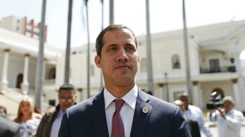 Venezuelan opposition leader Juan Guaido, who has declared himself interim president, arrives to the