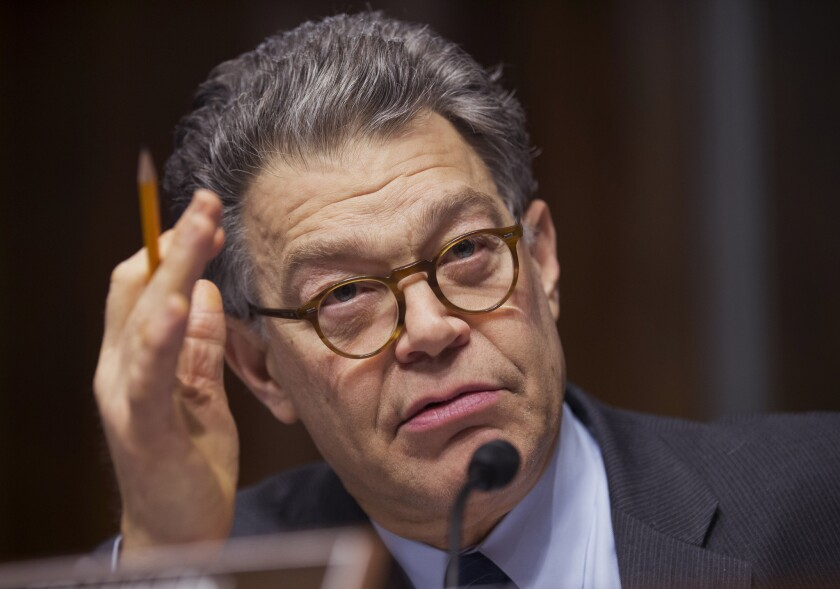 Former Sen. Al Franken questions a panel of witnesses during a hearing on Capitol Hill.