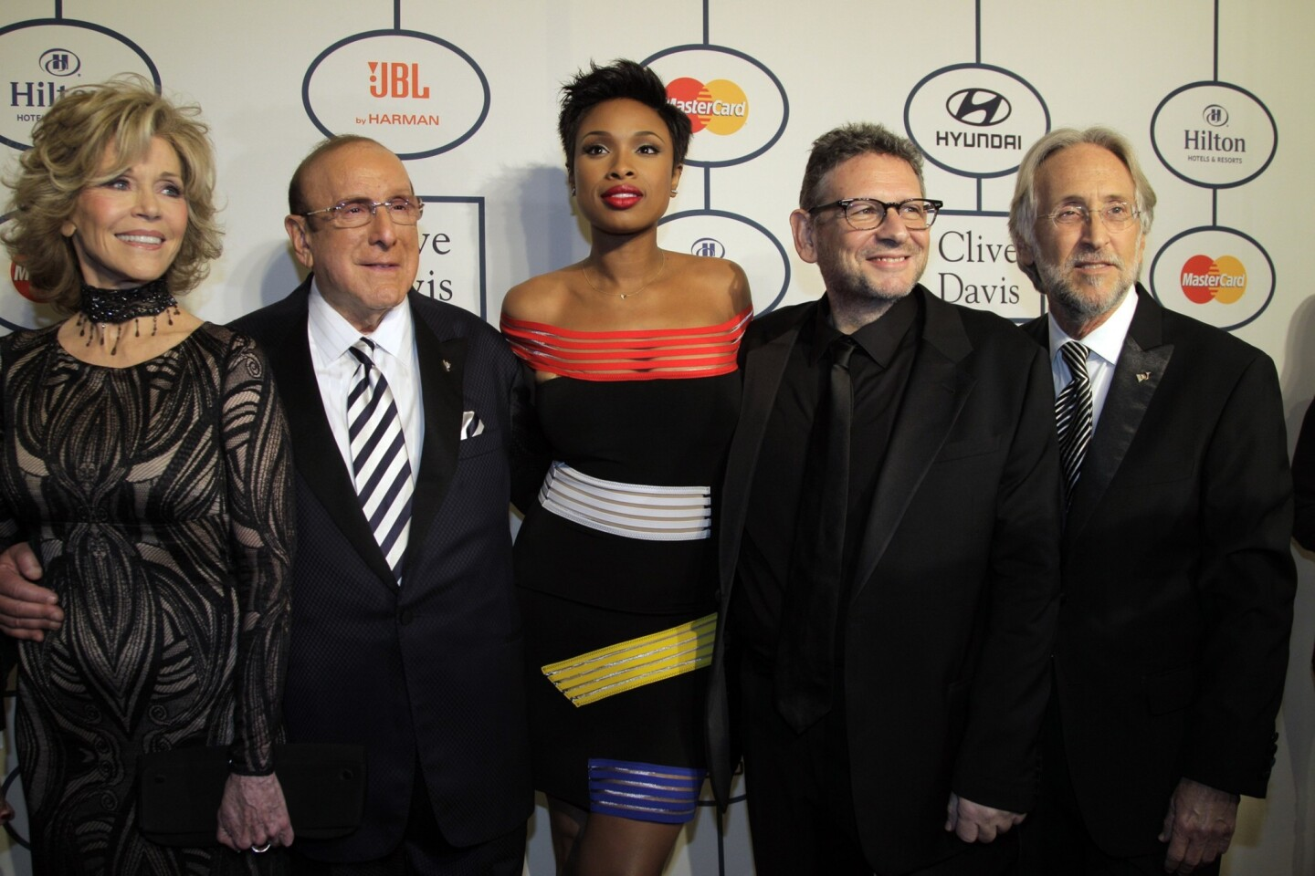 From left, Jane Fonda, Clive Davis, Jennifer Hudson, Lucian Grainge and Neil Portnow pose on the red carpet for the 2014 Pre-Grammy Gala, a salute to industry icons that included Davis honoring Grainge, at the Beverly Hilton.