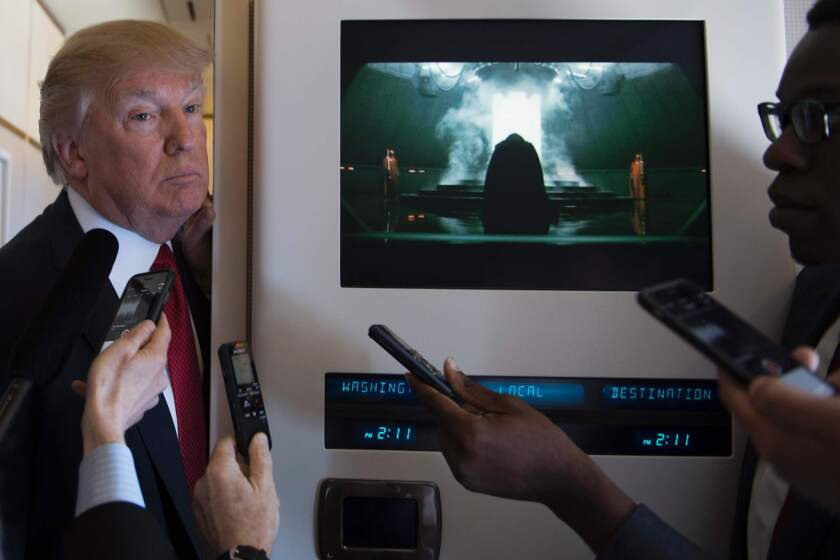 President Trump speaks to the media April 6 on Air Force One, shortly after a meeting of his national security team to discuss military action against Syria.
