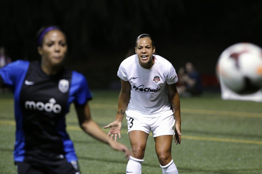 FILE - In this Aug. 24, 2014, file photo, Washington Spirit's Toni Pressley (3) yells as Seattle Reign FC's Sydney Leroux follows the ball during the first half of a NWSL semifinal soccer match in Seattle. Pressley was looking forward to a comeback season with the Orlando Pride this year after overcoming breast cancer. But then life threw the veteran defender another curve with the coronavirus pandemic and the impact it would ultimately have on the Pride, who were left out of this summer's Challenge Cup tournament. (AP Photo/Elaine Thompson, File)