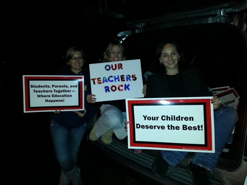Parents Jillian Dailey, Wendy Gilbert and Kellie Peel (from left) waited for hours Friday in the parking lot of the Alpine Union School District in hopes of learning an agreement had been reached in labor negotiations between teachers and management.