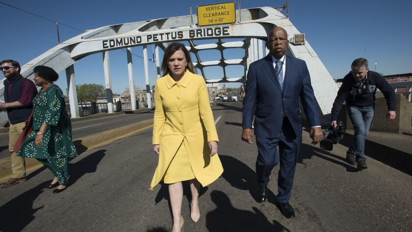 Congressman John Lewis walks with Joan M. Mooney, The Faith & Politics Institute president, on the E