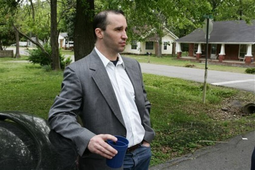 FILE - In this Tuesday April 23, 2013 file photo, Everett Dutschke stands in the street near his home in Tupelo, Miss., and waits for the FBI to arrive and search his home. Ricin has been found in a business once used by Dutschke who was charged in the case of letters laced with the deadly poison b