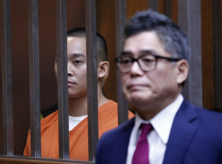 James Tran appears in Sacramento County Superior Court, with attorney Donald Masuda, to face an attempted homicide charge in last month's stabbing of Air Force Staff Sgt. Spencer Stone, Friday, Nov. 6, 2015, in Sacramento, Calif. Tran did not enter a plea and will return to court in December.  Ston