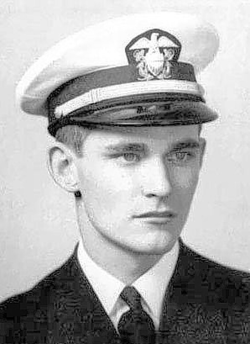 """Ensign John C. England died aboard the battleship Oklahoma during the Japanese attack on Pearl Harbor and his remains are believed to be among those buried in a Hawaii grave for """"unknowns."""" His relatives hope to identify and bring them home."""