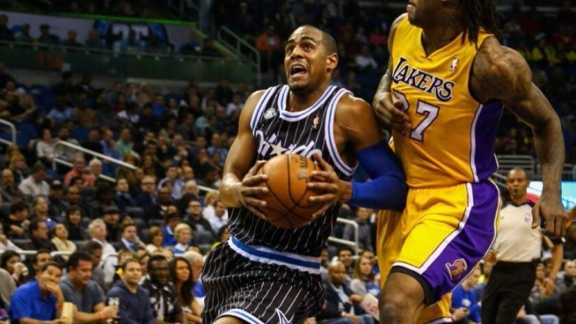 Professional basketball player Arron Afflalo, left, has sold his home in Ladera Heights for $1.9 million.