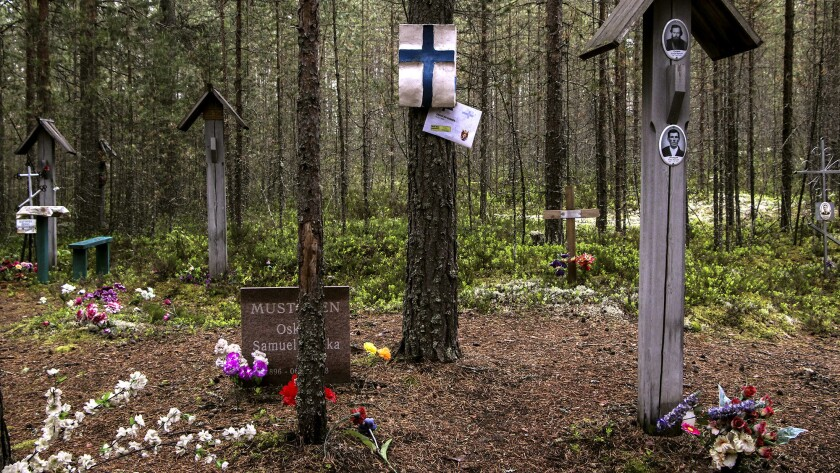 A Finnish banner is hung from a tree at the Sandarmokh mass execution site in northwestern Russia.