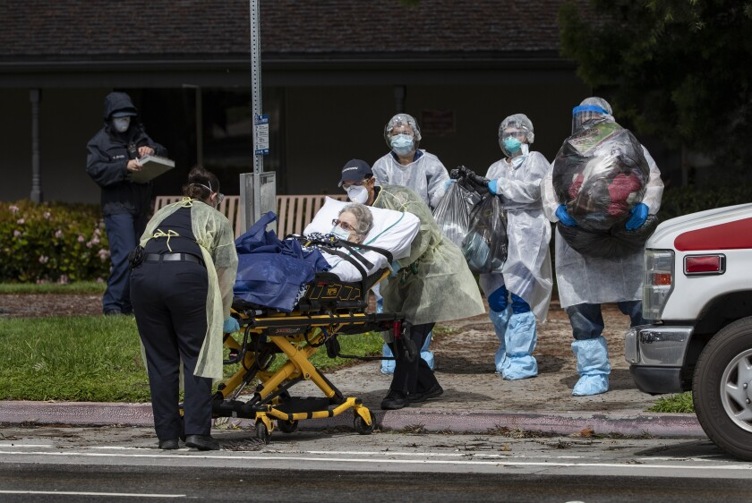 Medical staff evacuate a patient from the Magnolia Rehabilitation and Nursing Center in Riverside in April.