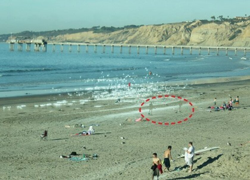 The ghost image of people (circled) as well as the sun's glare (both from the south side of the beach), are projected onto the northernmost glass of the Shores' new lifeguard tower in late afternoon. Lifeguards say this effect makes it difficult to accurately assess the situation in the wat