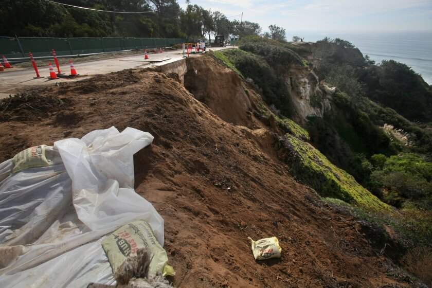 Crews are working to repair the cave in under Camino del Mar along the coast between Del Mar Heights and Carmel Valley Road. Severe storm damage last week caused the collapse of a small bluff and affected both a storm drain and a gas pipe, causing the road closure. One northbound lane will be open soon, but complete road access is months away.