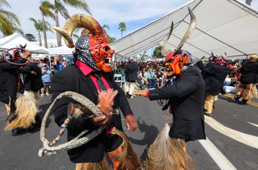 Dancers from Danza De Diablos (Dance of Devils) perform a traditional dance from the Mexican state of Oaxaca at Oceanside's Mexican Independence Day celebration on Pier View Way, adjacent to the Oceanside Civic Center.