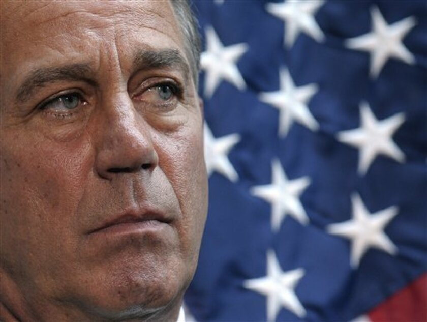 House Speaker John Boehner of Ohio waits to speak during a news conference on Capitol Hill in Washington, Tuesday, July 12, 2011, as the budget talks continued. (AP Photo/Susan Walsh)