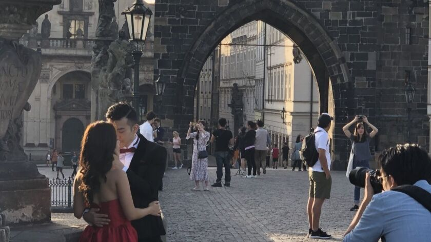 Erica Leung, 26, poses with fiance Sze Sze, 28, for pre-wedding pictures in Prague, the Czech capital.