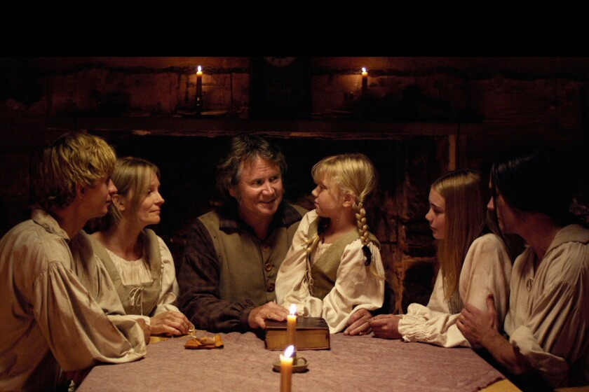 Papa Leininger (Robert Pierce) reads the Bible aloud to his family, reminding them that God will never leave them or forsake them.