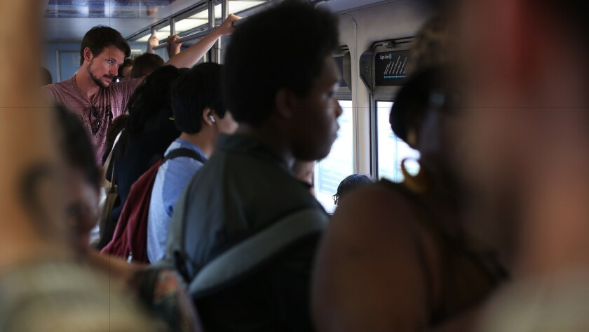 Commuters pack an eastbound Expo Line train into downtown Los Angeles.