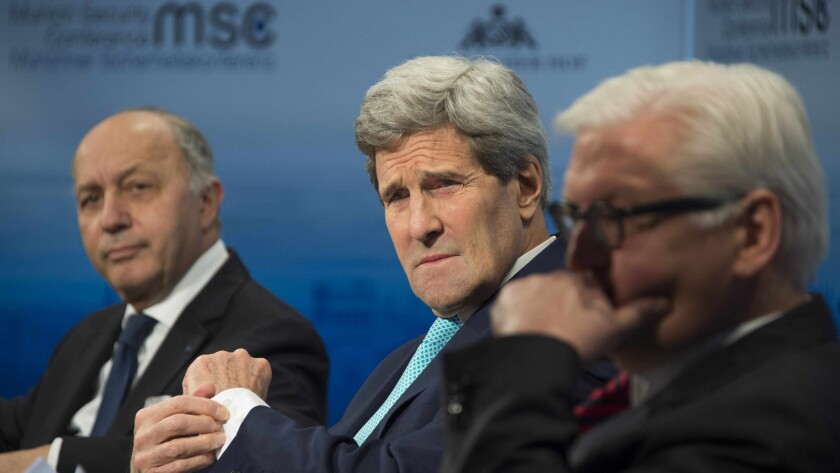 U.S. Secretary of State John F. Kerry, center, talks with French Foreign Minister Laurent Fabius, left, and German Foreign Minister Frank-Walter Steinmeier at the 51st Munich Security Conference.