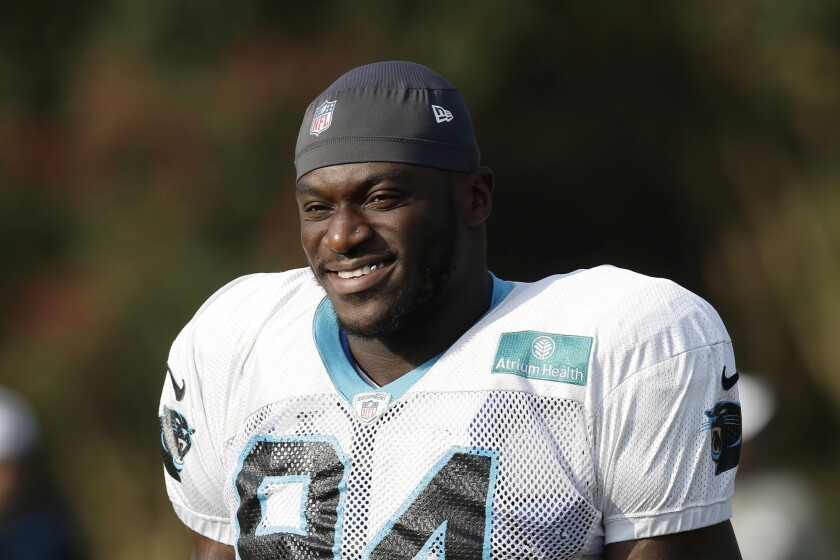 """FILE - In this Aug. 13, 2019, file photo, then-Carolina Panthers' Efe Obada (94) takes the field during an NFL football training camp in Spartanburg, S.C. Obada has a beaming smile and quick to crack a joke, such as the one about how he chose an NFL career over taking up UFC because, """"I'm too pretty."""" The Bills defensive end's easy-going approach belies his difficult journey from Nigeria to North America. (AP Photo/Gerry Broome, File)"""