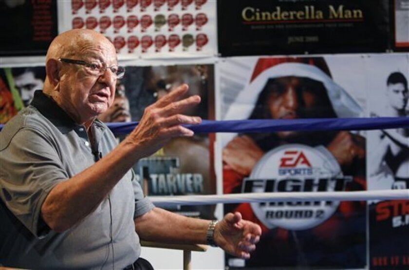 FILE - In this Sept. 23, 2012, file photo, Angelo Dundee gestures during an interview at the opening of the new 5th Street Gym in Miami Beach, Fla. Dundee, the trainer who helped groom Muhammad Ali and Sugar Ray Leonard into world champions and became one of boxing's most recognizable figures, died Wednesday, Feb. 1, 2012. He was 90. (AP Photo/Wilfredo Lee, File)