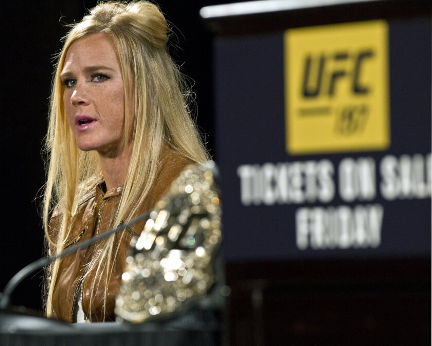 UFC 197 fighter Holly Holm answers a question during a news conference at the MGM Grand in Las Vegas.