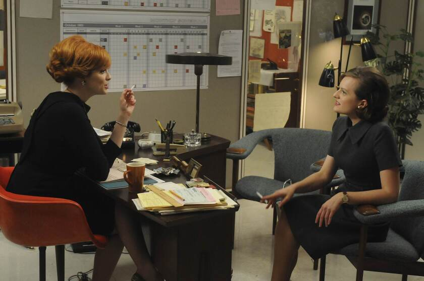 """Christina Hendricks, left, as Joan and Elisabeth Moss as Peggy in """"Mad Men."""""""