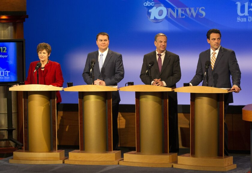 Candidates for San Diego mayor, (left to right) Bonnie Dumanis, Carl DeMaio, Bob Filner and Nathan Fletcher prepare to debate at a KPBS debate Thursday.