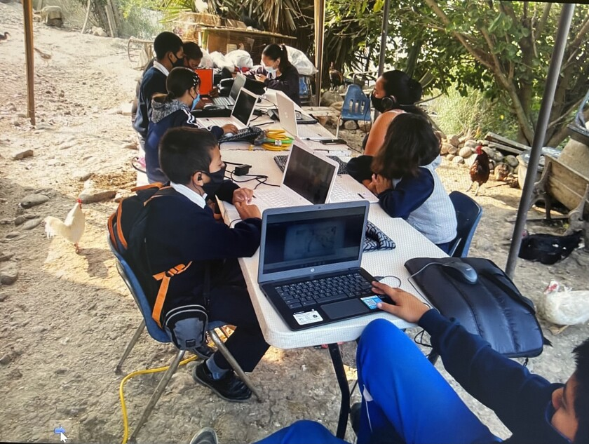 Students with donated laptops