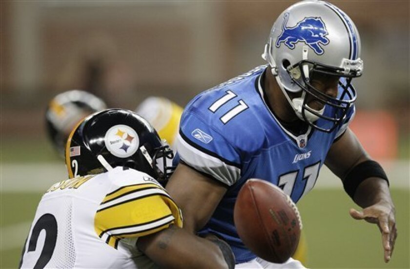 Pittsburgh Steelers defensive end James Harrison, left, strips the ball while sacking Detroit Lions quarterback Daunte Culpepper during the first quarter of an NFL football game in Detroit, Sunday, Oct. 11, 2009. Culpepper recovered the fumble. (AP Photo/Paul Sancya)