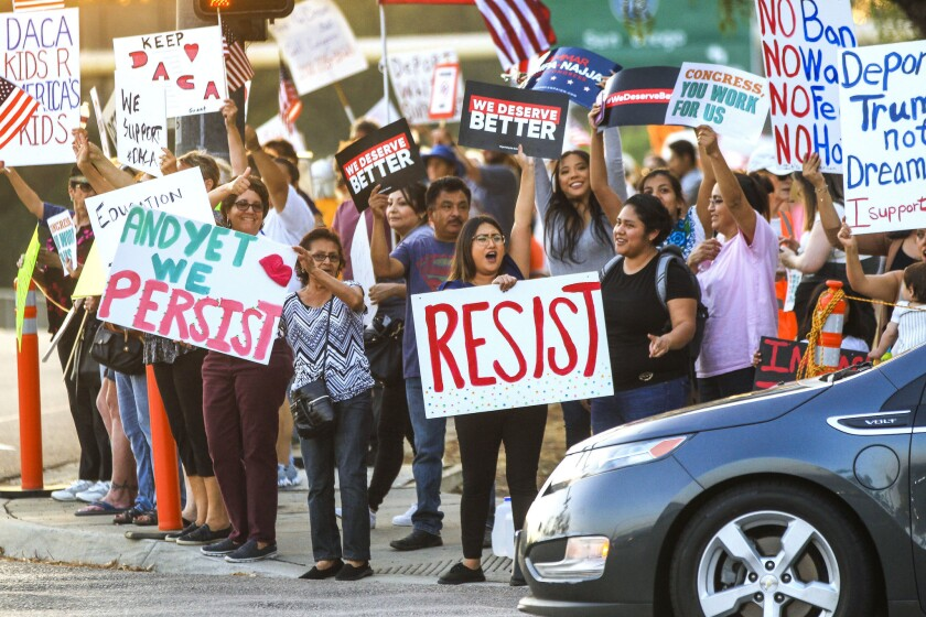 People protest President Trump's decision to end the DACA program