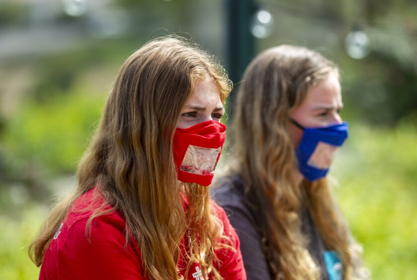 Maggie Dietrick, left, who is deaf and her sister Kate, who is hearing impaired, have helped to create masks for the deaf community.