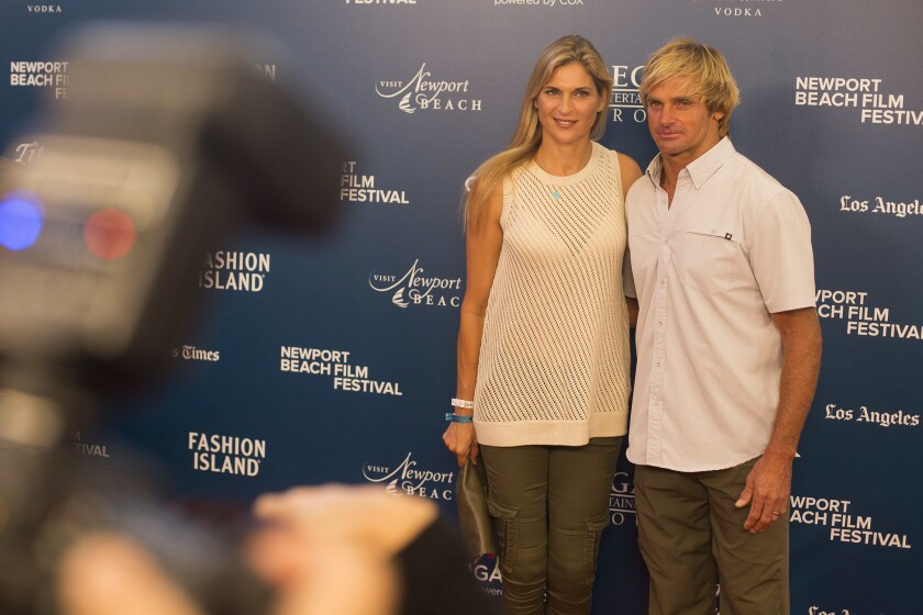 "Gabrielle Reece and Laird Hamilton pose for photographs on the red carpet of the 18th annual Newport Film Festival Thursday night. Hamilton is the subject of the opening night movie, ""Take Every Wave: The Life of Laird Hamilton."""